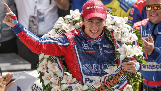 Andretti Autosport IndyCar driver Takuma Sato (26) celebrates his win in victory circle after the 101st running of the Indy 500 at Indianapolis Motor Speedway on Sunday, May 28, 2017.