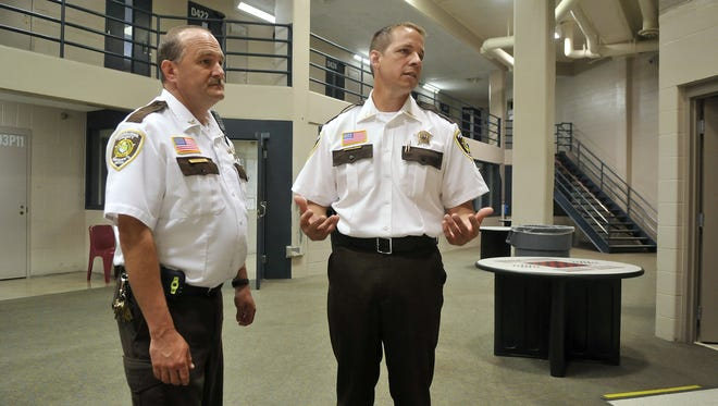 Sherburne County Jail Commander Patrick Carr, left, and Sheriff Joel Brott are shown at the jail in this file photo from June 2013.