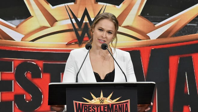 Professional wrestler Ronda Rousey speaks at a news conference in East Rutherford, N.J., Friday, March 16, 2018. The WWE, the New York Jets and Giants of the NFL and the state of New Jersey announced the 35th edition of the wrestling extravaganza will be held at Metlife Stadium on April 7, 2019. The week-long showcase will feature four events at Barclays Center. The last time WrestleMania was held at MetLife Stadium was in 2013, and it drew a crowd of 80,000 people.