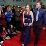 Pleasant High School rolls out the red carpet for the student body as parents enjoy the show at this year's prom held at the Harding Center on Saturday, April 25, 2015.
