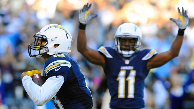 San Diego Chargers receiver Keenan Allen (13) and receiver Eddie Royal (11) celebrate after a touchdown reception during the second half against the Oakland Raiders at Qualcomm Stadium.