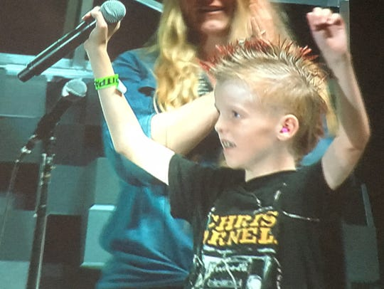 Young fan who joined Chris Stapleton on stage during