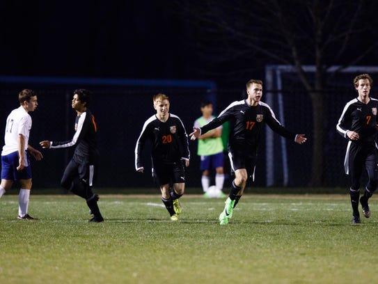 Ames' Ben Feddersen (17) celebrates a goal in the first