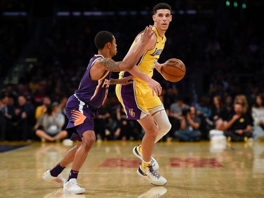 Lakers guard Lonzo Ball is defended by Suns guard Tyler Ulis on Nov. 17.