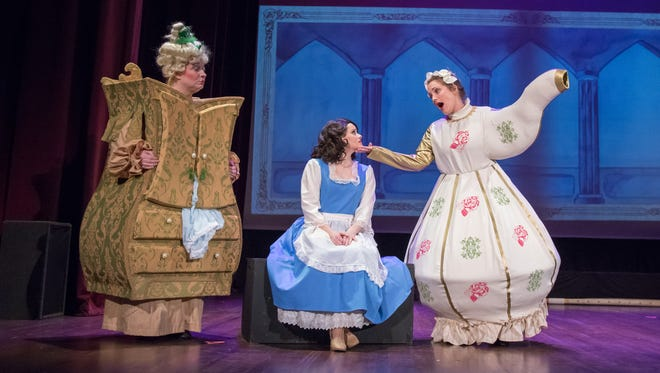 """Madame DelaGrand Bouche (Janeen Hilbrink), Mrs. Potts (Kirsten Manning) and Belle (Debbie May Hill) at a dress rehearsal of """"Beauty and the Beast."""""""