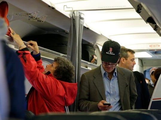 AP Cellphones Planes Travelers