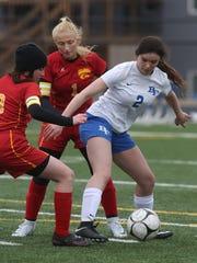 Bondurant-Farrar sophomore Emma De Costa tires to keep the ball away from Carlisle defender in a match from last season.