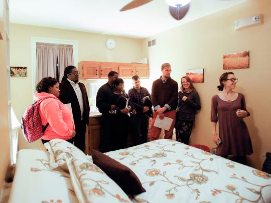 Nurse Jenn Sikes (right) shows a birthing room during a tour for prospective parents and family members at the Birth Center in Wilmington.