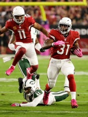 Arizona Cardinals running back David Johnson runs for a 58-yard touchdown against the New York Jets in the first quarter on Oct. 17, 2016 in Glendale, AZ.