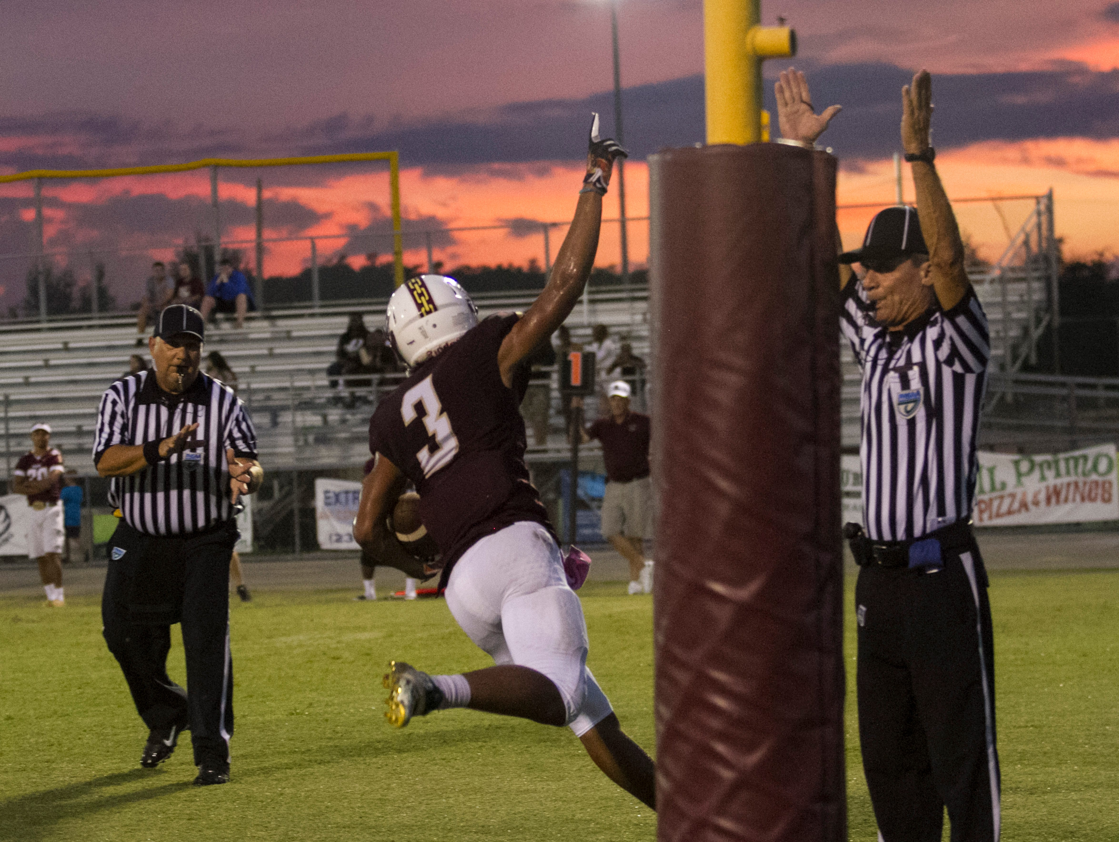 Riverdale's Jaylin Cochran celebrates scoring their first touchdown against East Lee on Friday, September 16, 2016, at Riverdale High School.