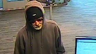 Security camera image of man suspected of robbing the Merchants Bank branch on College Street in  Burlington the morning of Saturday, May 21,  2016.