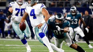 Dallas Cowboys quarterback Dak Prescott (4) is sacked by Eagles defensive end Derek Barnett (96) in the first half Sunday night.