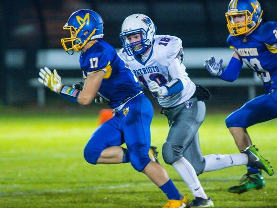 Milton's Seth Herrity, left, is chased down by Mt.