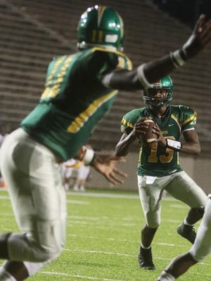 G.W. Carver's Kole Williams looks toward Ja'Torrian Fuller-Jones during the Wolverines' win over Stanhope Elmore on Friday at Cramton Bowl.