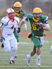 St. Norbert College receiver Zach Reeves (87) returns