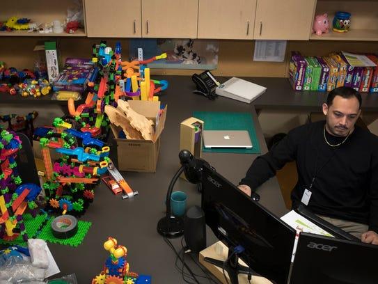Andres Cadada works in the design department Dec. 5,