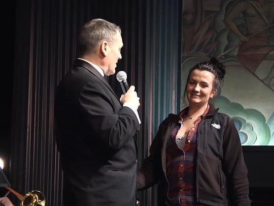 Sean Reilly serenades Katie Bird on stage at the Milton