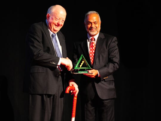 "Acadiana businessman J. Hubert ""Red"" Dumesnil accepts the UL-Lafayette B.I. Moody, III College of Business award from Dr. Joby John, dean of the College of Business, during the Junior Achievement of Acadiana's Business Hall of Fame ceremony at the Acadiana Center for the Arts in Lafayette, LA, May 7, 2013.