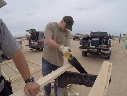 Southern Miss linebacker Paxton Schrimsher saws during a mission trip to Puerto Peñasco, Mexico, in March.
