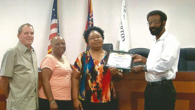 Lumberton Mayor Ben Winston presents Dr. Carla Holder with the Citizen of the Month award.