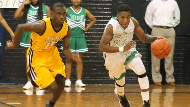 Fair Park's Carl Beasley chases Bossier's Travis Manning in the boys championship game at the Doc Edwards Invitational earlier this season. The two defending district champs will be fighting for one crown this year.