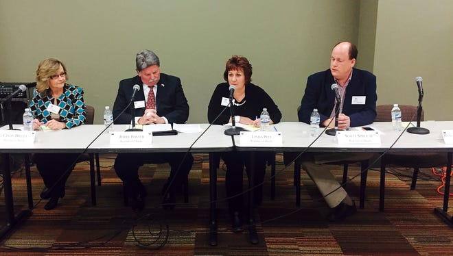 Cindy Briley (left), Jerry Foster, Linda Pitt and Scott Sprouse participate in a forum hosted by the League of Women Voters of Hendersonville at the Hendersonville Public Library on Monday.