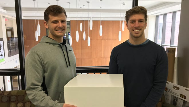 University of Wisconsin-Oshkosh seniors Brad Plock, left, and Dylan Park show an example of a standing desk for elementary students they designed for their business, Upright Kids. They'll pitch the concept April 6-8 at the e-Fest Business Plan Competition in Minneapolis.