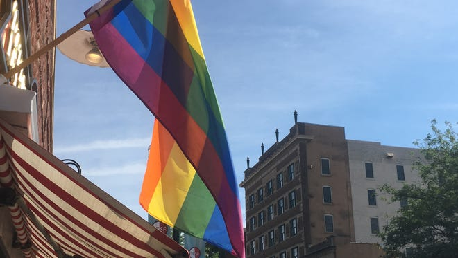 A rainbow flag flies over Vishnu Bunny Tattoo & Piercing, a downtown business and sponsor of the Sioux Falls Pride Festival.