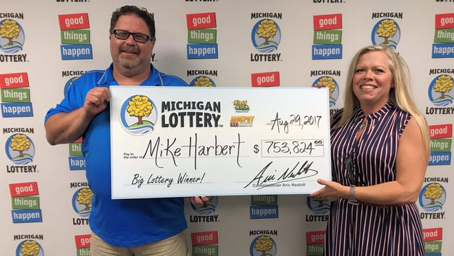 Mike and Sherrie Harbert claimed a $753,824 progressive jackpot prize Tuesday, Aug. 29, 2017. Mike Harbert won the prize playing the Michigan Lottery's Fast Cash Jackpot Slots game at his family's country store in Unadilla Township.