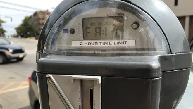 "A parking meter in Bloomfield reads ""fail."""
