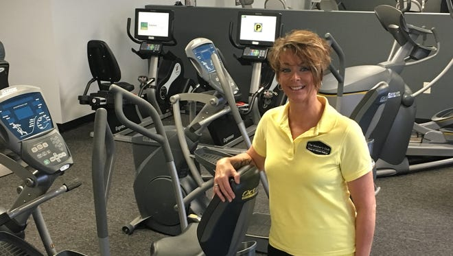 Teri Thompson-Katzenberger, owner of The Master's Club, stands inside the newly opened fitness club for those aged 40 and above.