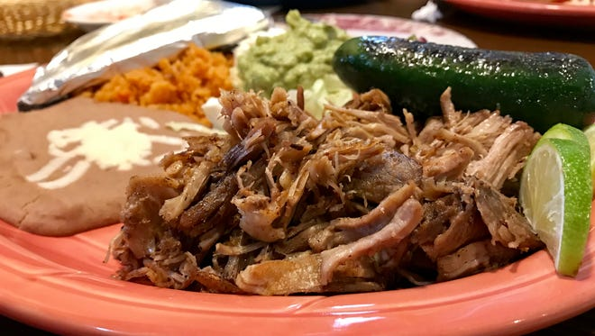 Carnitas with rice, beans and guacamole from El Toro.