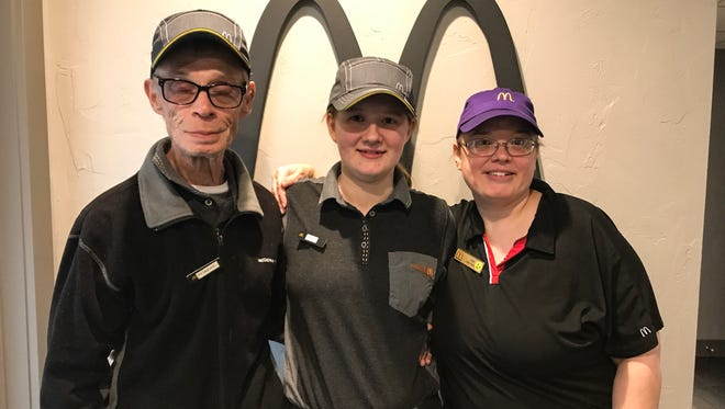 Robert Roach, Ashley Smith and Liz Smith are three generations of a family all working at the same McDonald's at the same time.