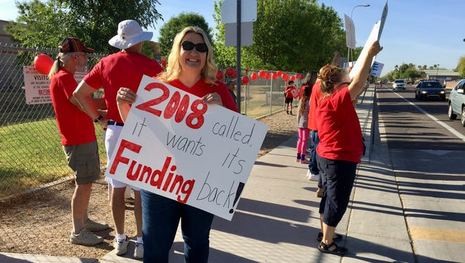 Jennifer Zamenski, a teacher for 21 years, joins the #RedForEd walk-in demonstration on April 11, 2018.