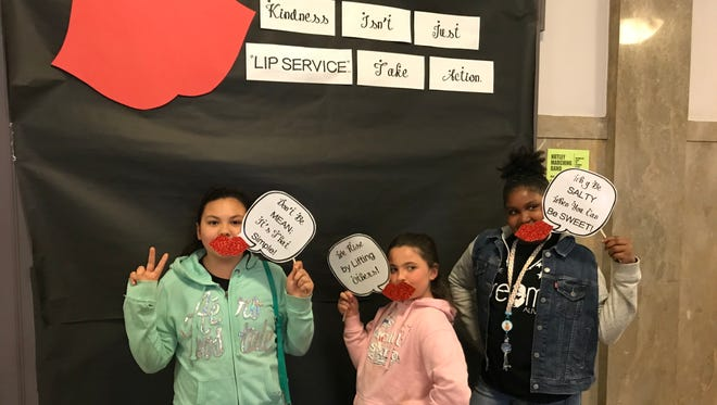 """From left, Vincenza Gabriele, Kara McClafferty and Sheena Cameron-Ash show """"kindness isn't just lip service"""" on April 17, 2018, outside Nutley's screening of """"Finding Kind,"""" a documentary addressing girl-against-girl bullying."""