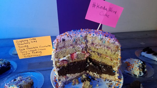 "Tracy Hoida's ""Kind Weird Cake"" was one of the culinary highlights of the Cincinnati Fringe Festival's Tuesday evening kickoff. True to its name, it had an abundance of flavors competing for attention; raspberry cake, strawberry cake, an entirely layer of brownie, dark chocolate ganache, berry whipped cream, lemon frosting and buttercream frosting. Hoida, an education associate at the Playhouse in the Park, is the creator of a Fringe Development event called ""The Origin of Kick Jab Girl."""