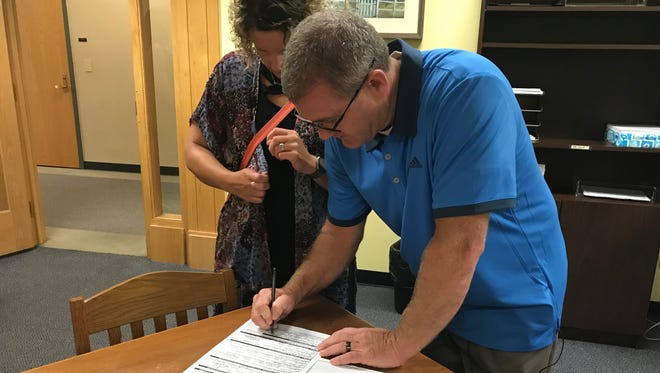 Bob Goldsmith, a lieutenant with the Tippecanoe County Sheriff's Office, files Friday, June 22, to run for sheriff as a Democrat. With him is Angie Aldridge, who will be treasurer on her campaign.