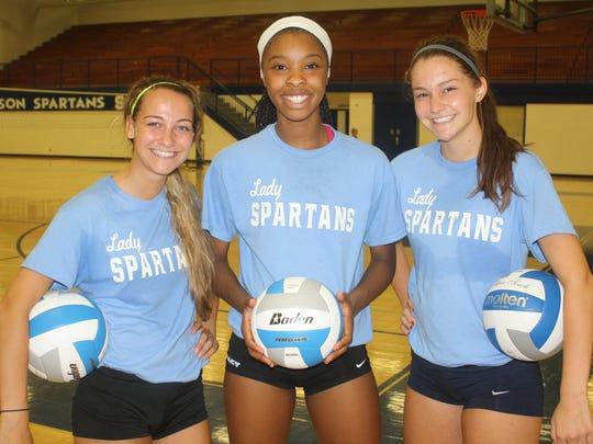 Pictured are Livonia Stevenson's three senior volleyball