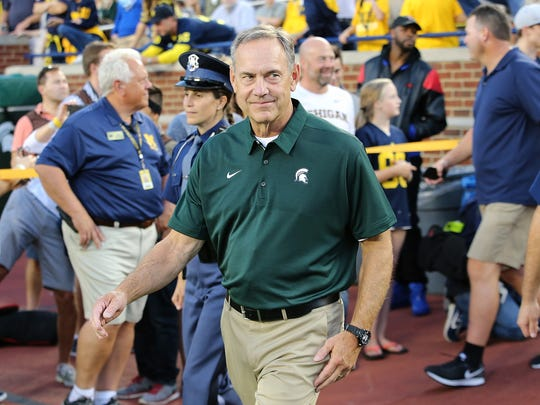 Michigan State coach Mark Dantonio smiles as he enters the field prior to the game against Michigan at Michigan Stadium on Oct. 7, 2017 in Ann Arbor.