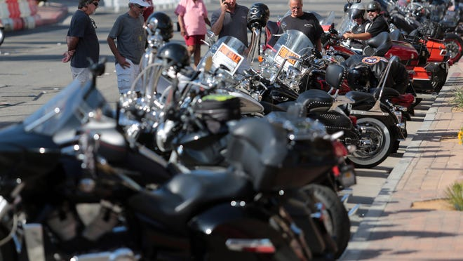 Bikers roll into downtown Palm Springs for the annual American Heat Motorcycle Rally this weekend. Photo taken on Friday, October 10, 2014 in Palm Springs.