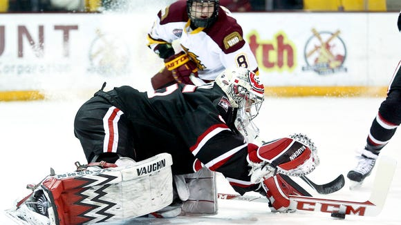 St. Cloud State goaltender Charlie Lindgren (35) dives out of the goal to cover up the puck during Friday's game against Minnesota Duluth at Amsoil Arena in Duluth. Minnesota Duluth defeated St. Cloud State 4-2.