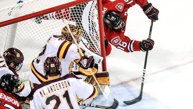 t012618 --- Clint Austin --- 012718.S.DNT.UMDMPUX.C05 --- Judd Peterson (18) of St. Cloud State shoots the puck on goal against Minnesota Duluth goaltender Hunter Shepard (32) at Amsoil Arena in Duluth Friday night. Minnesota Duluth defeated St. Cloud State 5-1. (Clint Austin / caustin@duluthnews.com)