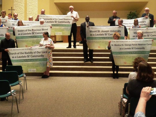 The 13 inaugural Laudato Si' communities display their