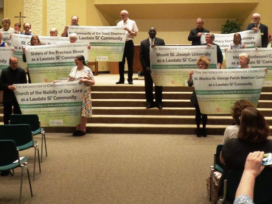 The 13 inaugural Laudato Si' communities display their banners during the recognition prayer service held June 18 at Community of the Good Shepherd Church.