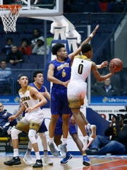 Irondequoit's Patrick Thomas sets up a block on Athena's Christian Jones who passes back in the first quarter at the Blue Cross Arena at the War Memorial.