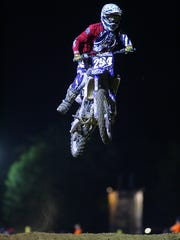 Riders participate in Motocross as the 2014 Hartford Fair.