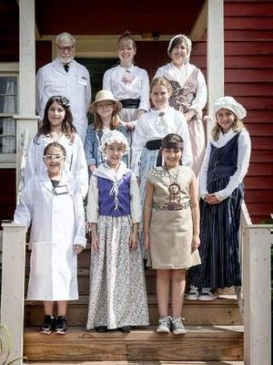 Campers dressed in period costume at the Historic Murray Farmhouse.