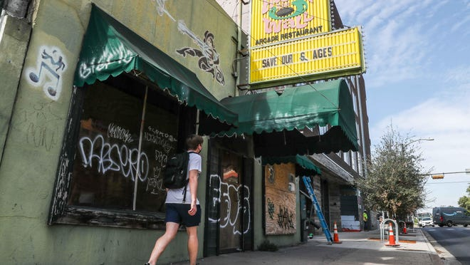 """The sign at the entrance to The Hole in the Wall reads """"Save our stages"""" on Wednesday. The venue on Guadalupe Street near the University of Texas remains closed due to the pandemic."""