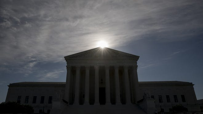 This May 4, 2020, file photo shows the Supreme Court building in Washington. Controversial Trump administration policies on the census, asylum seekers and the border wall, held illegal by lower courts, are on the Supreme Court's agenda Friday, Oct. 16, 2020.