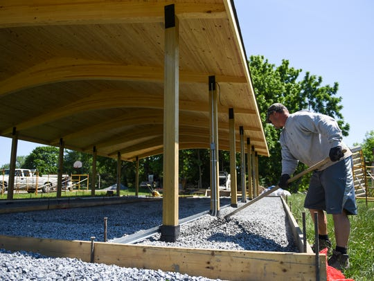 Jesse Brown, of J.B. Concrete, prepares the new pavilion